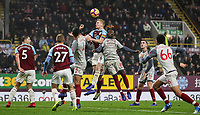 Burnley's Ben Mee heads<br /> <br /> Photographer Andrew Kearns/CameraSport<br /> <br /> The Premier League - Burnley v Liverpool - Wednesday 5th December 2018 - Turf Moor - Burnley<br /> <br /> World Copyright &copy; 2018 CameraSport. All rights reserved. 43 Linden Ave. Countesthorpe. Leicester. England. LE8 5PG - Tel: +44 (0) 116 277 4147 - admin@camerasport.com - www.camerasport.com