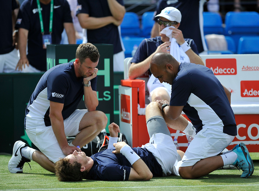 Captain Leon Smith (left) looks on as Andy Murray receives treatment for a groin strain during the match against Jo-Wilfried Tsonga and Nicolas Mahut in their doubles match today<br /> <br /> Photographer Ashley Western/CameraSport<br /> <br /> International Tennis - 2015 Davis Cup by BNP Paribas - World Group Quarterfinals - Great Britain v France - Day 2 - Saturday 18th July 2015 - Queens Club - London<br /> <br /> &copy; CameraSport - 43 Linden Ave. Countesthorpe. Leicester. England. LE8 5PG - Tel: +44 (0) 116 277 4147 - admin@camerasport.com - www.camerasport.com.