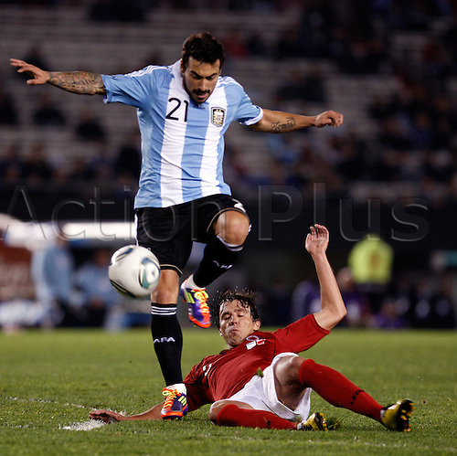 20.06.2011 Argentina's Ezequiel Lavezzi (L) vies with Albania's Andi Lila during the friendly football match at the Monumental stadium in Buenos Aires on June 20, 2011. Argentina won 4-0.