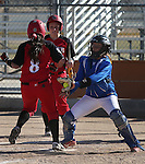 Western Nevada College's Hali Bennion makes the tag on Colorado Northwestern Community College's Jaisha Webb at Edmonds Sports Complex in Carson City,Nev., on Friday, Feb. 21, 2014. Western won 10-2 and 7-2. <br /> Photo by Cathleen Allison/Nevada Photo Source