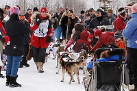 Saturday March 6 , 2010  Aliy Zirkle stops her team at her sponsor , Horizon Lines , annual Iditarod hot dog pit stop along the trail near Tudor Road during the ceremonial start of the 2010 Iditarod in Anchorage , Alaska and takes a break to take some of her own video images