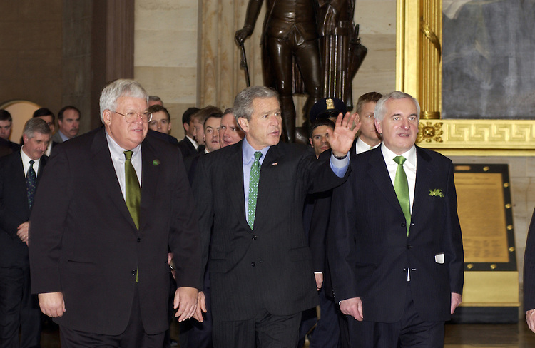 Speaker of the House Dennis Hastert, R-Ill., President George W. Bush, Prime Minister of Ireland Bertie Ahern, and Dermot Ahern Minister for Foreign Affairs, walk through the U.S. Capitol Rotunda after a St. Patrick's Day Luncheon.