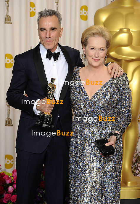 Daniel Day-Lewis with his Oscar for Best Actor in a leading role for Lincoln, alongside presenter Meryl Streep at the 85th Academy Awards at the Dolby Theatre, Los Angeles.