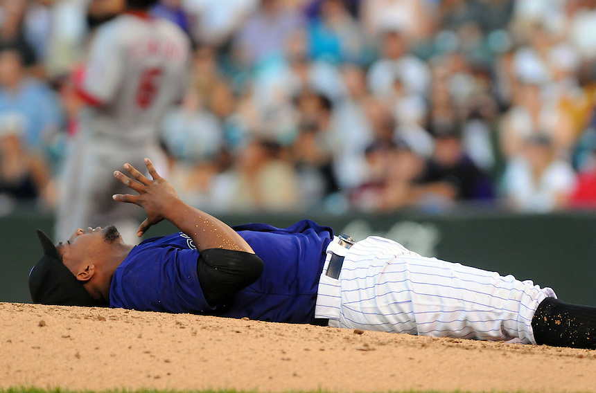 05 AUGUST 2011: Colorado Rockies starting pitcher Juan Nicasio (44) lies on the ground in pain after being hit in the head by a line drive, after which he was taken out of the game due to the injury during a regular season game between the Washington Nationals and the Colorado Rockies at Coors Field in Denver, Colorado. The Nationals beat the Rockies 5-3. *****For Editorial Use Only*****