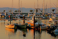 Day break at the La Cruz Marina Mexico and  colorful   water reflections of fishing boats.