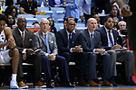 CHAPEL HILL, NC - DECEMBER 03: UNC coaching staff. From left: Steve Robinson, head coach Roy Williams, Hubert Davis, Brad Frederick, and Sean May. The University of North Carolina Tar Heels hosted the Tulane University Green Wave on December 3, 2017 at Dean E. Smith Center in Chapel Hill, NC in a Division I men's college basketball game. UNC won the game 97-73.