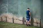 © Joel Goodman - 07973 332324 . . 12/06/2016 . Manchester , UK . Reveller urinating at the Parklife music festival at Heaton Park in Manchester . Photo credit : Joel Goodman