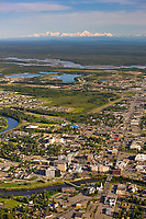 Aerial of the city of Fairbanks and the Alaska range mountains in the distance.