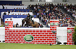 August 08, 2009: Cian O'Connor (IRL) aboard Markopoulo competing in the Puissance event. Land Rover International Puissance. Failte Ireland Horse Show. The RDS, Dublin, Ireland.