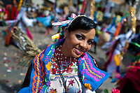A dancer (danzante) performs in the religious parade within the Corpus Christi festival in Pujilí, Ecuador, 10 June 2012. Every year in June, thousands of people gather in a small town of Pujili, high in the Andes, to celebrate the Catholic feast of Corpus Christi. Introduced originally during the Spanish conquest of South America, this celebration merges Catholic rituals of Holy Communion with the traditional Andean harvest and sun festivities (Inti, the Inca sun god). Women dancers perform wearing brightly colored costumes while men dancers wear chest ornaments and heavy elaborate headdresses adorned with mirrors, jewelry, or natural items (shells). Being a dancer in the Corpus Christi ceremonial parade (El Danzante) is considered an honour and a privilege by the indigenous people in Ecuador.