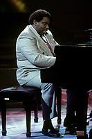 Montreal (Qc) CANADA - Circa 1994 File Photo -<br /> <br /> Oliver Jones at the Piano.<br /> <br /> Oliver Theophilus Jones (born on September 11, 1934 in Little Burgundy, Montreal, Quebec) is a Canadian jazz pianist, organist, composer and arranger.<br /> <br /> He began his career as a pianist at the age of five, studying with Mme Bonner in Little Burgundy's Union United Church, made famous by Trevor W. Payne's Montreal Jubilation Gospel Choir. However, for the most part, he developed his talent through his studies with Oscar Peterson's sister Daisy Peterson Sweeney. In addition to performing at Union United Church when he was a child, he also performed a solo novelty act at the Cafe St. Michel as well as other clubs and theaters in the Montreal area. He toured with a band called the Bandwagon while touring in the United States.<br /> <br /> In late 1980 he teamed up with Montreal's Charlie Biddle, working in and around local clubs and hotel lounges in Montreal. In fact he worked in and was resident pianist at Charlie Biddle's Jazz club, appropriately called Biddle's from 1981 to 1986. During the 1980s he was one of Canada's success stories amongst jazz musicians and has performed with Ranee Lee.<br /> <br /> He was travelling throughout Canada by the mid-1980s, appearing at festivals, concerts and clubs, either as a solo artist or with a trio: Skip Bey, Bernard Primeau, and Archie Alleyne. His travels also took him to Europe during this period.<br /> <br /> In 1986 he won a Juno Award for his album titled Lights of Burgundy and in 1989 he won the Félix Award for his album Just Friends. He taught music at Laurentian University in 1987, and in 1988 he taught music at McGill University in Montreal.<br /> <br /> -Photo (c)  Images Distribution