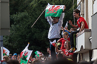 CARDIFF, UK. 8th July 2016. The Welsh football team are welcomed home with a public celebration event after reaching the semi-final of the Euro 2016 championship. After landing at Cardiff airport, an open-top bus parade took them through the city centre.