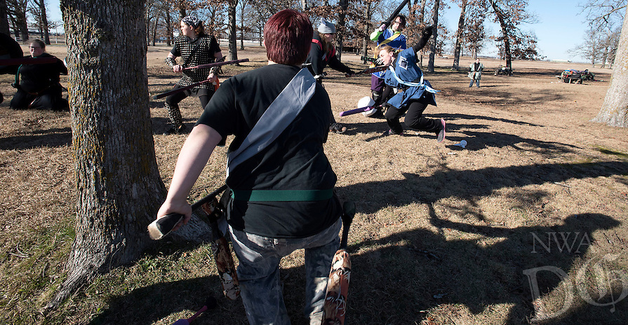 NWA Democrat-Gazette/J.T. WAMPLER Bryan Evans, known as Sandro, center, rushes headlong into battle Sunday Jan. 3, 2016 while participating in a live action role playing game, or LARP, at Agri Park in Fayetteville.  Around 15 members of the Shire of Razor Hills meet every Sunday at the park to engage in the live action combat game and use padded weapons to bludgeon each other during a variety of strategy scenarios. For more photos go to http://nwamedia.photoshelter.com/