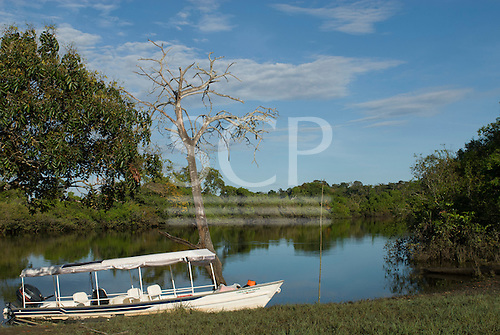 Xingu Indigenous Park, Mato Grosso State, Brazil. Port of Aldeia Matipu. The 'Coração do Brasil' voadeira aluminium boat of the Heart of Brazil Expedition.