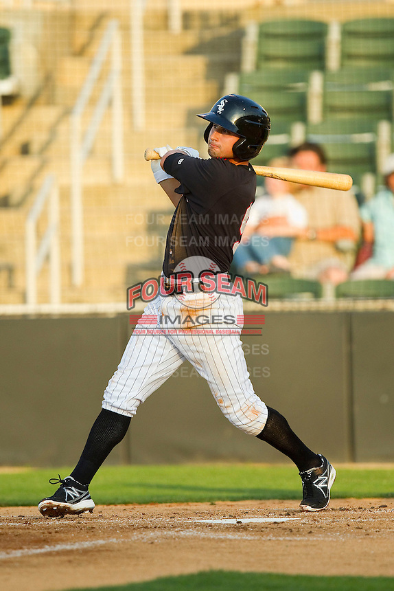 Michael Johnson (5) of the Kannapolis Intimidators follows through on his swing against the Hagerstown Suns at CMC-Northeast Stadium on May 17, 2013 in Kannapolis, North Carolina.  The Suns defeated the Intimidators 9-7.   (Brian Westerholt/Four Seam Images)