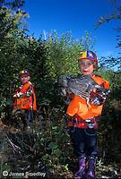 Young girl hunters holding shot ruffed grouse