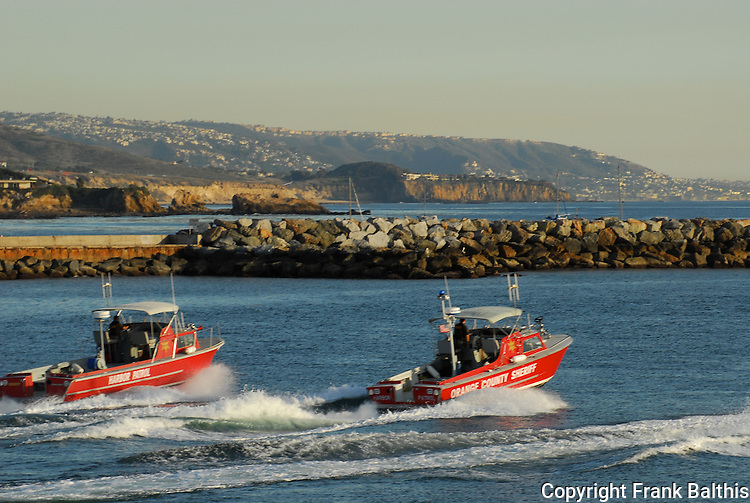 Orange County Sheriff and harbor patrol boats in Newport Beach