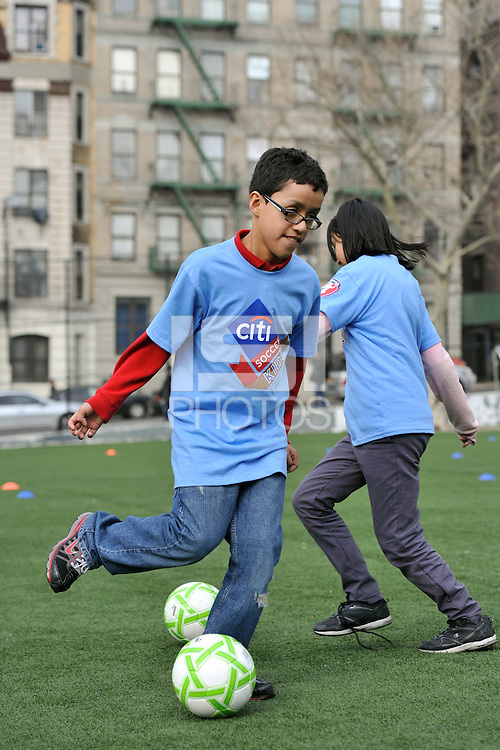 Students practice a drill during a Women's Professional Soccer (WPS) soccer clinic at PS 192 in Harlem, NY, on April 7, 2011.