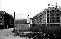 BOSNIA-HERZEGOVINA, Belgrade-Sarajevo Road, 03/2003..Lanscape pictures taken from the bus at Sarajevo. .The bus stops at the station who takes place in the Srpsjko Sarajevo (ex muslim quarter of Lukavica), a quarter of very new buildings and new churches..We are ten kilometers far from the old center of Sarajevo. The bus doesn't run anylonger. .BOSNIE-HERZEGONVINE, Route Belgrade-Sarajevo, 03/2003..Photo prise depuis le bus qui relie Belgrade à Sarajevo. Le bus s'arrete à la gare routière de Srpsjko Sarajevo (ex quartier musulman de Lukavica), un quartier où l'on construit de nouvelles habitations et de nouvelles églises. Le centre historique de Sarajevo est encore à 10 kms mais le bus ne va pas plus loin..© Bruno Cogez / Est&Ost Photography