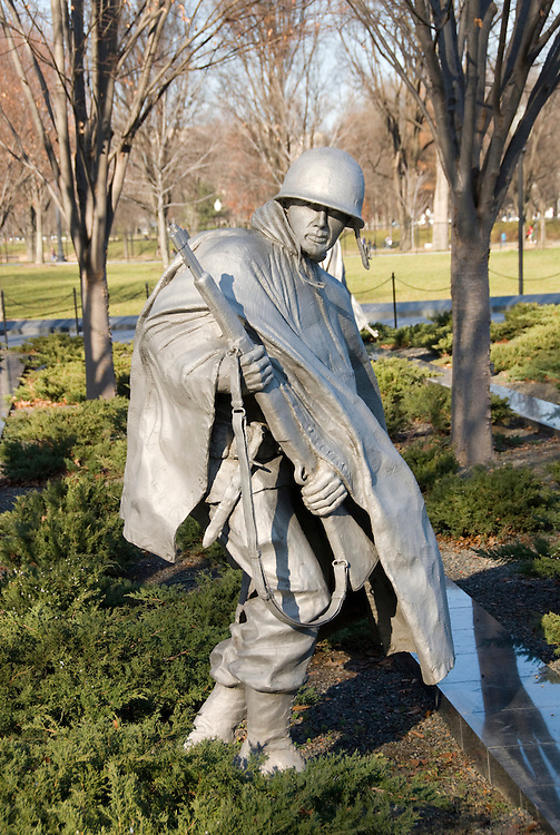 Washington DC; USA: The Korean War Veterans Memorial. The statue of a soldier in a platoon marches warily across a field..Photo copyright Lee Foster Photo # 9-washdc76136