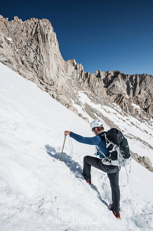 Hiker Ascending snowy chute on Mountaineers Route of Mount Whitney, Sierra Nevada Mountains, California