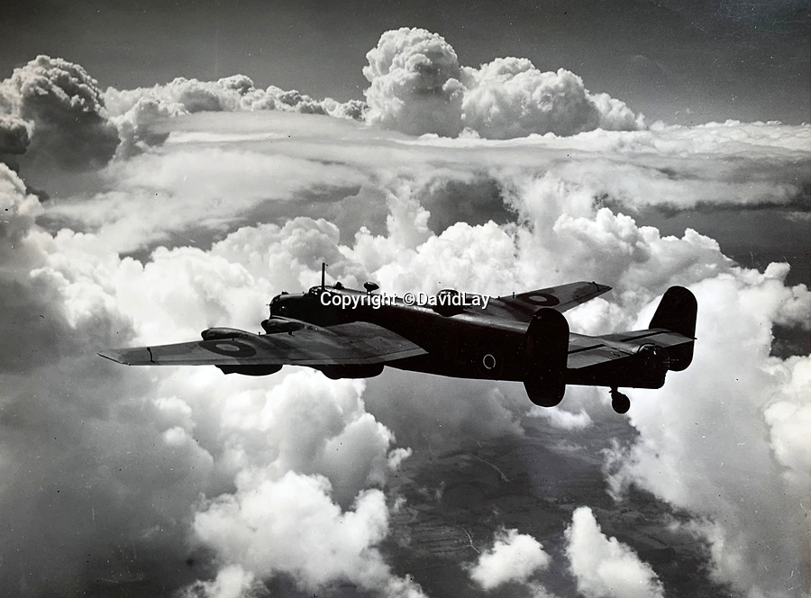 BNPS.co.uk (01202 558833)<br /> Pic:  DavidLay/BNPS<br /> <br /> Stunning picture of a Lancaster on a raid over Europe.<br /> <br /> Bomber command heroes WW2 exploits discovered in a shoebox.<br /> <br /> The personal effects of a fearless 'Tail-end Charlie' have been discovered in a shoebox - and they include a charming set of photos of his wartime service.<br /> <br /> Flight Sergeant Douglas Alexander, of 460 Squadron, took part in nearly 40 bombing raids over Germany, including the famous assault on Hitler's mountain retreat, Berchtesgaden.<br /> <br /> As a tail gunner, he sat in a tiny glass turret at the rear of Lancaster and Halifax bombers - a terribly exposed position.<br /> <br /> The shoebox, containing his bravery medals, logbooks and photos, was bought into auctioneer David Lay Frics, of Penzance, Cornwall, by his daughter.<br /> <br /> Flt Sgt Alexander's medal group includes the prestigious Distinguished Flying Medal, awarded for 'exceptional valour, courage and devotion to duty', with his photos capturing the camarederie which existed in the RAF as the airmen risked their lives on every mission to defeat Adolf Hitler.