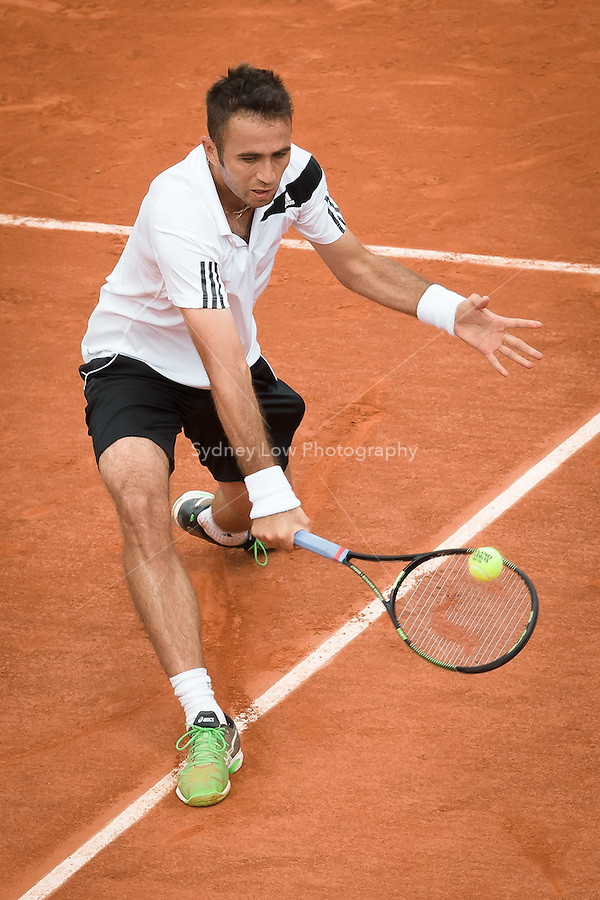 May 24, 2015: Marsel Ilhan (TUR) in action in a 1st round match against Stan Wawrinka (SUI) on day one of the 2015 French Open tennis tournament at Roland Garros in Paris, France. Wawrinka won 63 62 63. Sydney Low/AsteriskImages