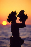 Conch shell blower at sunset, Hawaii