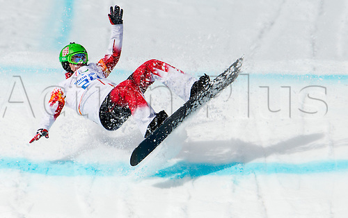 14.03.2014. Sochi, Russia.  Ian Lockey of Canada crashes during the Men's Para-Snowboard in Rosa Khutor Alpine Center at the Sochi 2014 Paralympic Winter Games, Krasnaya Polyana, Russia, 14 March 2014.