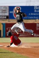 Brandon Crawford -  2009 San Jose Giants (California League) attempts a double play over a sliding Juan Diaz against the High Desert Mavericks at Maverick Stadium, Adelanto, CA - 04/26/2009..Photo by:  Bill Mitchell/Four Seam Images