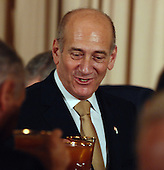 Washington, D.C. - November 26, 2007 -- Prime Minister Ehud Olmert of Israel participates in a toast during a dinner at the State Department in Washington on the eve of a Middle East peace conference on November 26, 2007. United States President George W. Bush is hosting Palestinian President Mahmoud Abbas and Israeli Prime Minister Ehud Olmert.  .Credit: Roger L. Wollenberg - Pool via CNP
