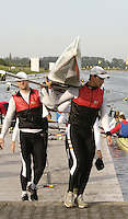 Munich, GERMANY, German M8+ is carried froom the boating dock. at the  2006, FISA, Rowing, World Cup, held on the Olympic Regatta Course, Munich, Thurs. 25.05.2006. © Peter Spurrier/Intersport-images.com,  / Mobile +44 [0] 7973 819 551 / email images@intersport-images.com.[Mandatory Credit, Peter Spurier/ Intersport Images] Rowing Course, Olympic Regatta Rowing Course, Munich, GERMANY