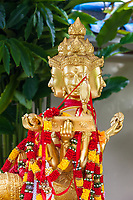 Statue of Hindu Lord Brahma, Gift of Thailand, Popular among Chinese Tourists, Kek Lok Si Buddhist Temple, George Town, Penang, Malaysia.  This is similar to the statue of Lord Brahma in the Erawan Shrine in Bangkok.