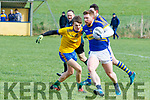 Referee Tom Corbett keeps a close eye on Padraig Healy, Glenflesk and Cathal Dunne, Ballymac  during the Senior Football League, Division 2, Round 1 game played at Ballymac GAA ground last Sunday.