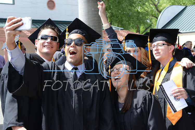 Graduates take photos at the 2015 Western Nevada College Commencement held at the Pony Express Pavilion in Carson City, Nev., on Monday, May 18, 2015.<br /> Photo by Tim Dunn