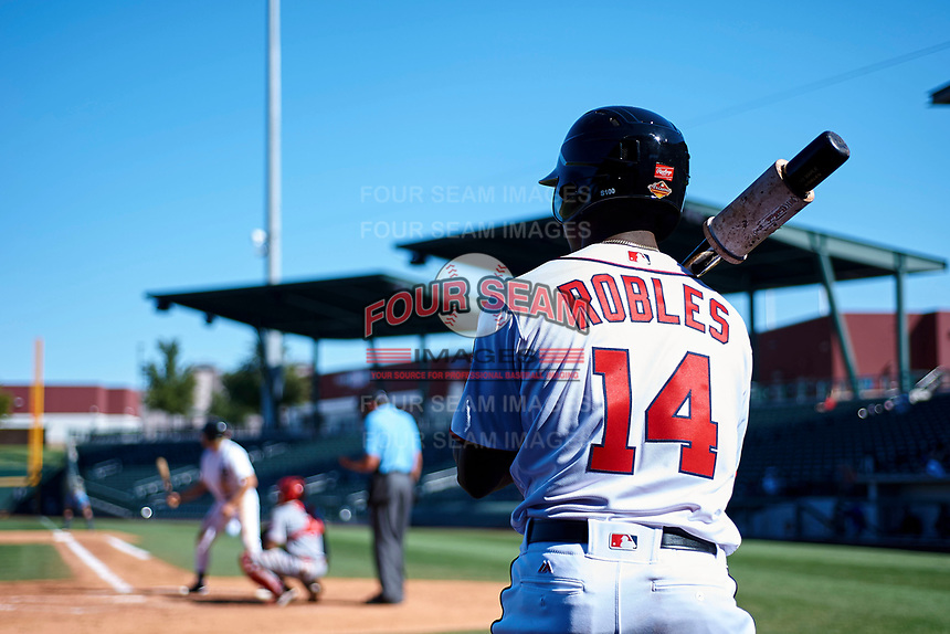 Mesa Solar Sox designated hitter Victor Robles (14), of the Washington Nationals organization, on deck as Cam Gibson (5), of the Detroit Tigers organization, bats during an Arizona Fall League game against the Scottsdale Scorpions on October 24, 2017 at Sloan Park in Mesa, Arizona. The Scorpions defeated the Solar Sox 3-1. (Zachary Lucy/Four Seam Images)