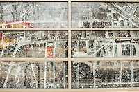An old aerial map of the West End neighborhood adorns the window of the Durham Co-op Market Grocery and Cafe in Durham, N.C. on Thursday, March 26, 2015. (Justin Cook)