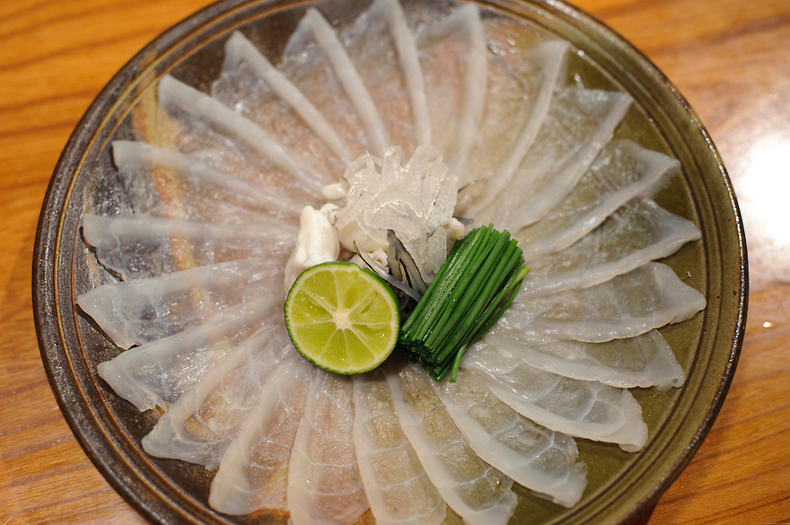 Fugu sashimi served with chives, fugu skin and yuzu sudachi citrus, Otsubo fugu restaurant, Tokyo, Japan, October 24 2009.