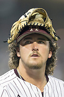 Mississippi State pitcher Jonathan Holder (14) after during Game 1 of the 2013 Men's College World Series Finals against the UCLA Bruins on June 24, 2013 at TD Ameritrade Park in Omaha, Nebraska. The Bruins defeated the Bulldogs 3-1, taking a 1-0 lead in the best of 3 series. (Andrew Woolley/Four Seam Images)