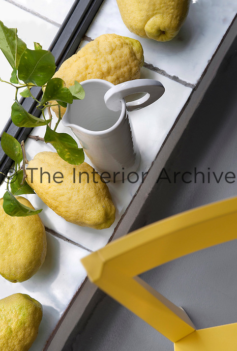 Misshapen lemons are left to ripen on a tiled window still in the kitchen