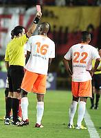 BOGOTA - COLOMBIA -26 -03-2014: Carlos Betancur (Izq.), arbitro muestra tarjeta roja a Freddy Hurtado (Der.) jugador de Envigado FC  durante partido aplazado entre Independiente Santa Fe y Envigado Chico FC por la fecha 10 de la Liga Postobon I-2014, jugado en el estadio Nemesio Camacho El Campin de la ciudad de Bogota. / Carlos Betancur (L), referee shows red card to Freddy Hurtado (R) player of Envigado FC during a posponed match between Independiente Santa Fe and Envigado FC for the 10th date of the Liga Postobon I -2014 at the Nemesio Camacho El Campin Stadium in Bogota city, Photo: VizzorImage  / Luis Ramirez