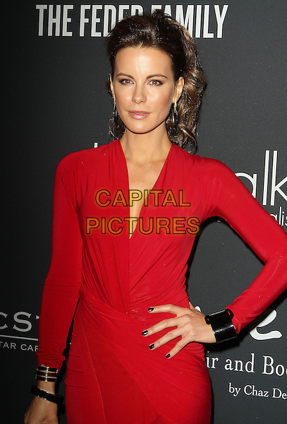 Kate Beckinsale<br /> The Pink Party 2013 held at the Santa Monica Airport, Santa Monica, California, USA.<br /> October 19th, 2013<br /> half length dress red black  wrap  hand on hip cuff bracelet<br /> CAP/ADM/KB<br /> &copy;Kevan Brooks/AdMedia/Capital Pictures