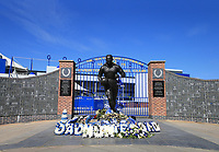 May 8th 2020, Liverpool, United Kingdom;  Everton's Goodison Park stadium during the suspension of the Premier League. The statue of legendary former Everton player Dixie Dean outside the locked gates of the stadium entrance