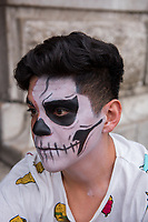 Mexico, Mexico City. Day of the Dead, Dia de los Muertos. People painting their faces.