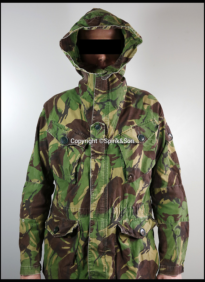 BNPS.co.uk (01202 558833)<br /> Pic: Spink&Son/BNPS<br /> <br /> Warrant Officer David John Harvey's jacket.<br /> <br /> The bravery medals of a heroic SAS officer who went behind enemy lines in the Falklands War, supported missile hunting teams in Desert Storm and did multiple tours in Northern Ireland have emerged for auction and are tipped to sell for £20,000.<br /> <br /> Warrant Officer David John Harvey, known to his friends as 'Dia', was awarded seven medals during his distinguished 26 year career in the army and SAS.  <br /> <br /> After 15 years in the army, he joined the SAS in August 1981 and with the advent of hostilities in the South Atlantic was deployed in a four-man patrol in the Falklands which undertook surveillance and carried out a selfless diversionary attack under heavy mortar fire at Port Stanley.<br /> <br /> In the Gulf War, he went undercover to replenish SCUD-hunting (tactical ballistic missiles) teams such as 'Bravo Two Zero'.<br /> <br /> The 66 year-old trained Oman's special forces in the 1990s and served on the security personnel of a British diplomat in Iraq at the dawn of the Iraq War in 2003 where he narrowly escaped death in a suicide bombing.<br /> <br /> WO Harvey has decided to auction his medals through London-based Spink & Son, which will sell them on Wednesday.