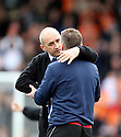 Luton Town manager Richard Money consoles Stevenage manager Graham Westley after Luton's victory in the  Blue Square Premier match between Stevenage Borough and Luton Town at the Lamex Stadium, Broadhall Way, Stevenage on Saturday 3rd April, 2010..© Kevin Coleman 2010 .