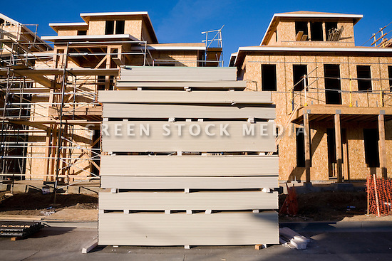 A stack of gypsum wallboard by the real estate developer D. R. Horton's 181-unit housing development called Arbor Real. The project under construction consists of luxury townhouses and condominiums on the site of the former Rickey's Hyatt adjacent to El Camino Real.