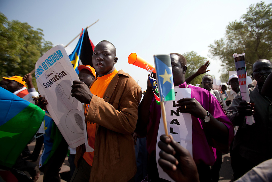 9 december 2010 - Juba, South Sudan - Southern Sudanese citizens chant slogans and hold placards as they march in the streets in support of the independence referendum in Juba, South Sudan. The referendum on whether the oil-producing region should declare independence, scheduled for Jan. 9, is the climax of a 2005 peace deal that ended decades of north-south conflict - Africa's longest civil war that was fought over ethnicity, religion, ideology and oil and that killed 2 million people. Photo credit: Benedicte Desrus
