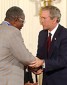 United States President George W. Bush honors Hank Aaron with the Presidential Medal of Freedom during a ceremony in the East Room of the White House in Washington, DC on 9 July, 2002.<br /> Credit: Ron Sachs / CNP