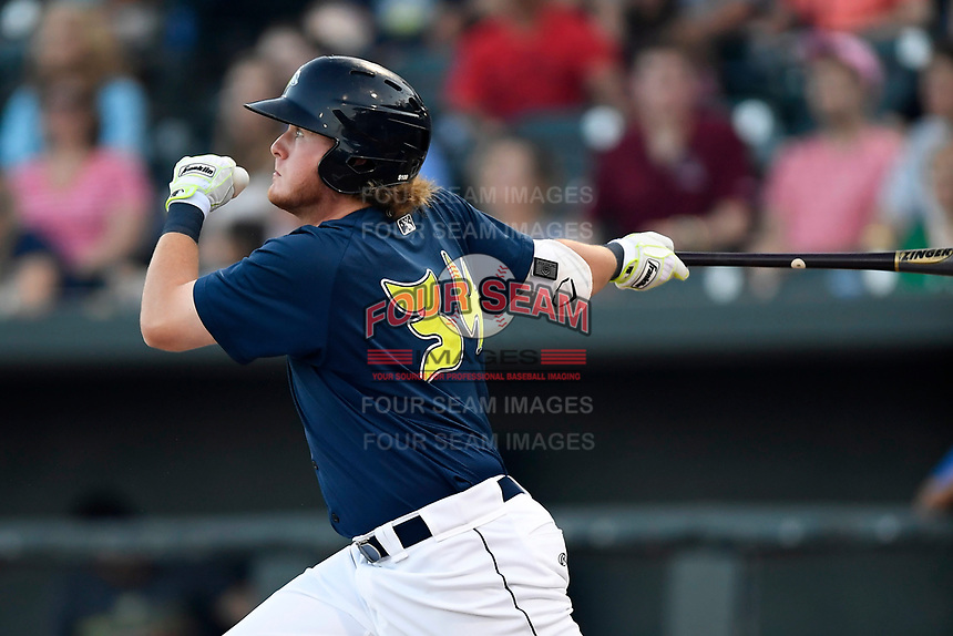 First baseman Dash Winningham (34) of the Columbia Fireflies hits his first of two home runs in a game against the Lexington Legends on Thursday, June 8, 2017, at Spirit Communications Park in Columbia, South Carolina. Columbia won, 8-0. (Tom Priddy/Four Seam Images)